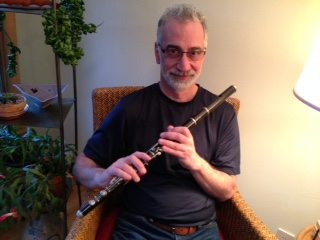 Dobbs' husband, Jesse Markow, with his grandfather's flute.